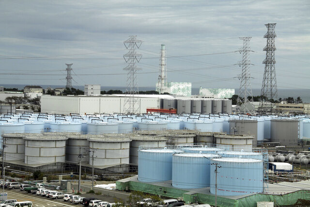 FILE - In this Oct. 12, 2017, file photo, ever-growing amount ofcontaminated, treated but still slightly radioactive, waterat the wreckedFukushima Dai-ichi nuclear plant is stored in about 900 huge tanks, including those seen in this photo taken during a plant tour at Fukushima Daiichi Nuclear Power Plant in Okuma, Fukushima prefecture, northeast of Tokyo. A government panel on Friday roughly accepted the economy and industry ministry's draft proposal that cites the gradual release of massive amounts of treated but still radioactive water stored at the tsunami-wrecked Fukushima nuclear plant to sea as a best option. (Pablo M. Diez/Pool Photo via A, File)
