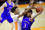 Tennessee guard Keon Johnson (45) defends against Kansas guard Dajuan Harris Jr. (3) during an NCAA college basketball game in Knoxville, Tenn., Saturday, Jan. 30, 2021. (Caitie McMekin/Knoxville News Sentinel via AP, Pool)