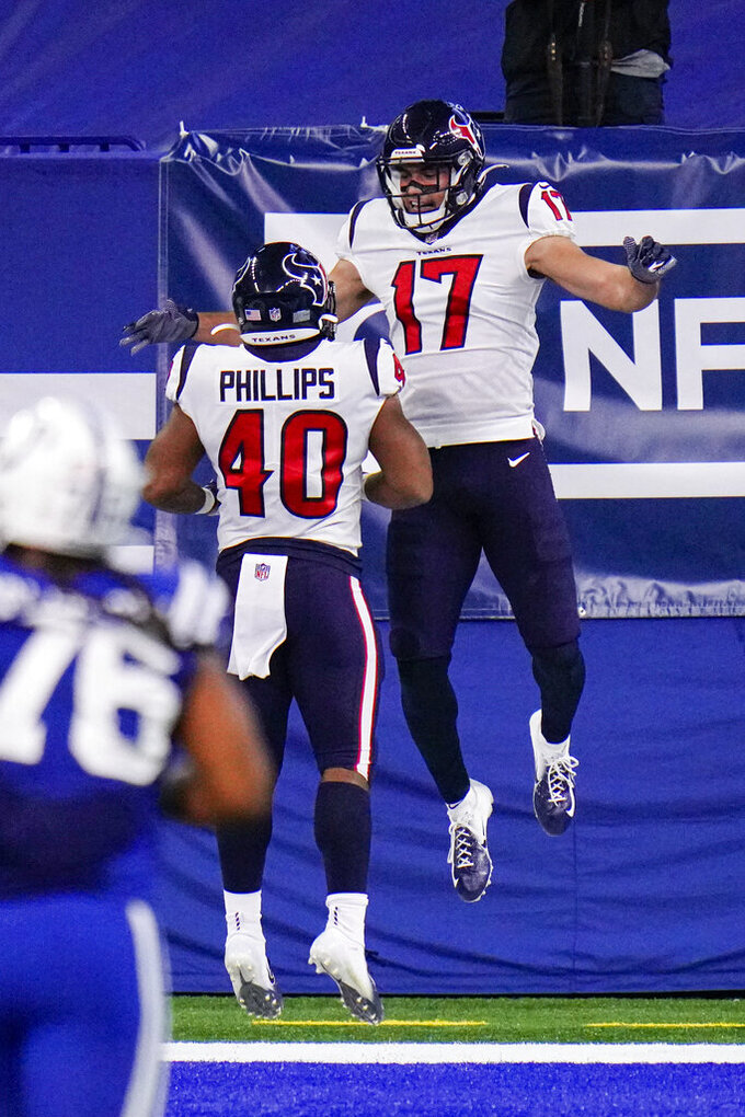 Houston Texans wide receiver Chad Hansen (17) celebrates a touchdown with running back Scottie Phillips (40) in the first half of an NFL football game against the Indianapolis Colts in Indianapolis, Sunday, Dec. 20, 2020. (AP Photo/AJ Mast)