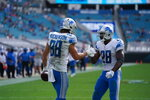 Detroit Lions running back Adrian Peterson (28) celebrating during a NFL football game against the Jacksonville Jaguars on Sunday, Oct. 18, 2020 in Jacksonville, FL. The Lions defeated the Jaguars 34-16 (Detroit Lions via AP).