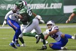 New York Jets' Le'Veon Bell (26) breaks a tackle by Buffalo Bills' Matt Milano (58) during the first half of an NFL football game Sunday, Sept. 8, 2019, in East Rutherford, N.J. (AP Photo/Bill Kostroun)
