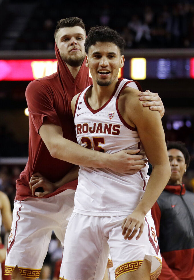 Southern California's Bennie Boatwright, right, is hugged by teammate Nick Rakocevic after a win over Arizona State in an NCAA college basketball game Saturday, Jan. 26, 2019, in Los Angeles. (AP Photo/Marcio Jose Sanchez)