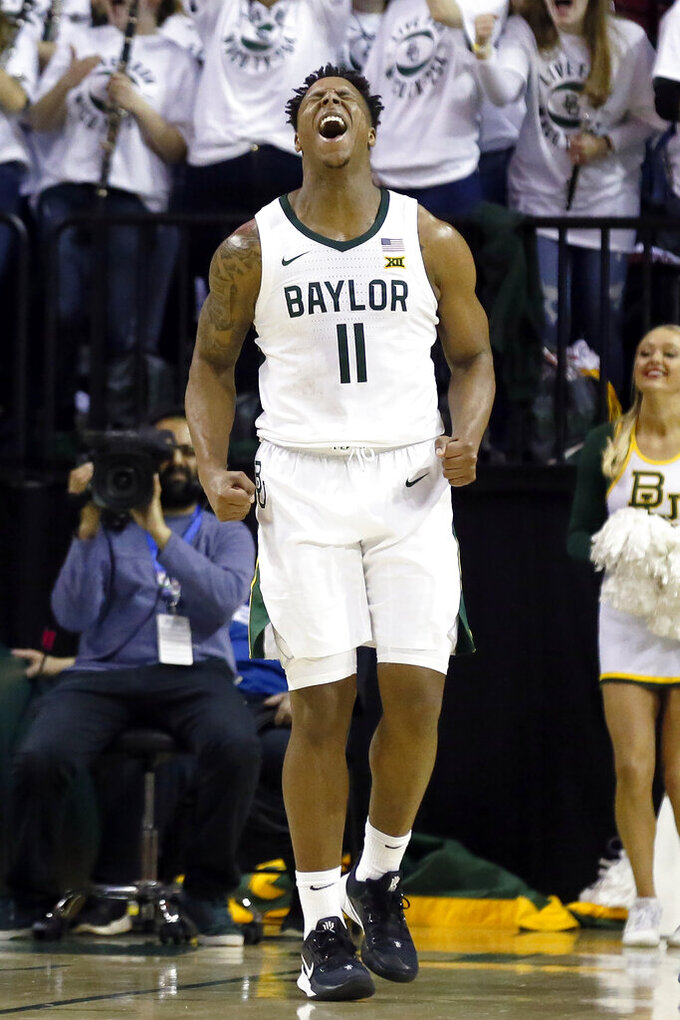Baylor guard Mark Vital reacts after a dunk against Kansas during the first half of an NCAA college basketball game on Saturday, Feb. 22, 2020, in Waco, Texas. (AP Photo/Ray Carlin)
