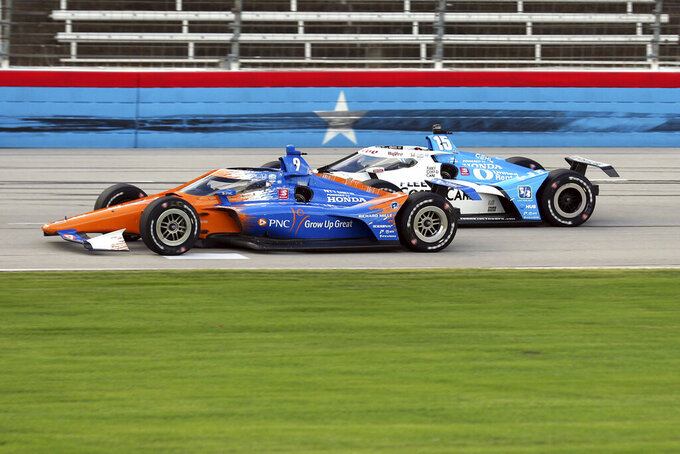 Scott Dixon tries to hold off Graham Rahal down the front stretch during an IndyCar Series auto race at Texas Motor Speedway on Sunday, May 2, 2021, in Fort Worth, Texas. (AP Photo/Richard W. Rodriguez)