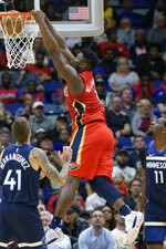 FILE - In this March 3, 2020, file photo, New Orleans Pelicans forward Zion Williamson (1) dunks next to Minnesota Timberwolves forward Juan Hernangomez (41) during the first half of an NBA basketball game in New Orleans. The Pelicans selected Williamson with the top pick in the 2019 draft. (AP Photo/Matthew Hinton, File)