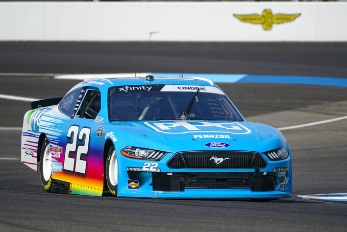 Austin Cindric (22) drives through a turn during qualifying for the NASCAR Xfinity Series auto race at Indianapolis Motor Speedway in Indianapolis, Saturday, Aug. 14, 2021. (AP Photo/Michael Conroy)