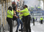 An anti-government protester is detained by police during a nationwide strike against President Lenin Moreno and his economic policies, in Quito, Ecuador, Wednesday, Oct. 9, 2019.  Protests, which began when Moreno's decision to cut subsidies led to a sharp increase in fuel prices, have persisted for days. (AP Photo/Dolores Ochoa)