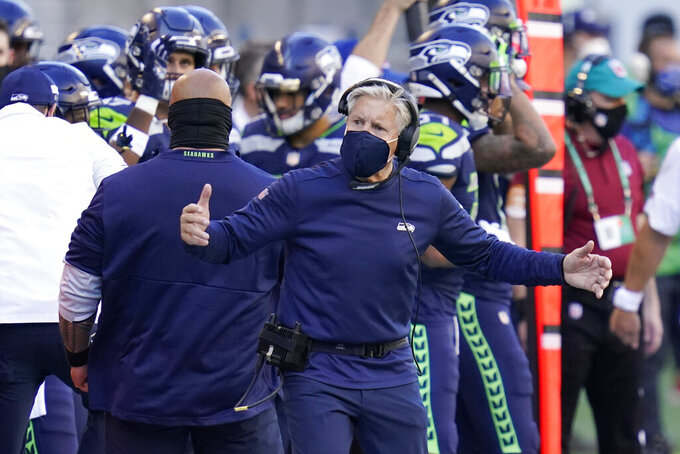 Seattle Seahawks head coach Pete Carroll reacts on the sideline during the second half of an NFL football game against the Dallas Cowboys, Sunday, Sept. 27, 2020, in Seattle. (AP Photo/Elaine Thompson)