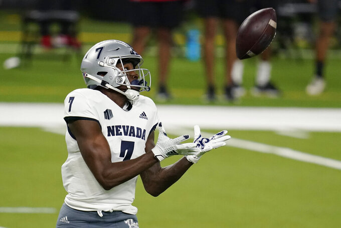 Nevada wide receiver Romeo Doubs catches a pass during the first half of an NCAA college football game against UNLV on Saturday, Oct. 31, 2020, in Las Vegas. (AP Photo/John Locher)