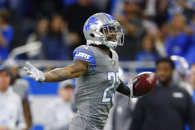Detroit Lions cornerback Darius Slay looks towards the fans after intercepting a pass during the second half of an NFL football game against the Chicago Bears, Thursday, Nov. 28, 2019, in Detroit. (AP Photo/Paul Sancya)
