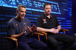 "Virginia head coach Tony Bennett, left, and Texas Tech head coach Chris Beard talk as during an interview for CBS Sports Network's ""We Need to Talk"" show before the championship game of the Final Four NCAA college basketball tournament, Sunday, April 7, 2019, in Minneapolis. (AP Photo/David J. Phillip)"