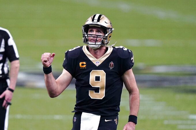 New Orleans Saints quarterback Drew Brees (9) reacts after throwing touchdown pass in the second half of an NFL football game against the Kansas City Chiefs in New Orleans, Sunday, Dec. 20, 2020. (AP Photo/Butch Dill)