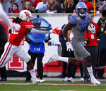 Memphis wide receiver Damonte Coxie, right, runs past Houston linebacker Terrance Edgeston for a touchdown during the first half of an NCAA college football game, Saturday, Nov. 16, 2019, in Houston. (AP Photo/Eric Christian Smith)