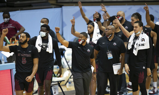 Members of the North Carolina Central team point to the North Carolina Tar Heels at the conclusion of their NCAA college basketball game, Saturday, Dec. 12, 2020, at the Smith Center in Chapel Hill, N.C. (Robert Willett/The News & Observer via AP)