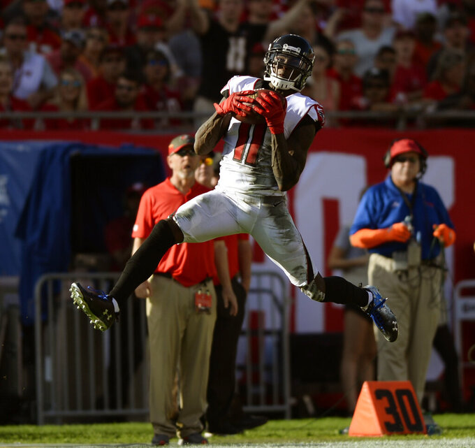 FILE - In this Dec. 30, 2018, file photo, Atlanta Falcons wide receiver Julio Jones (11) pulls in a reception against the Tampa Bay Buccaneers during the second half of an NFL football game, in Tampa, Fla. The Falcons have started their offseason conditioning program without wide receiver Julio Jones for the second straight year. (AP Photo/Jason Behnken, File)