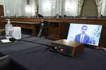 Google's CEO Sundar Pichais appears on a screen as he speaks remotely during a hearing before the Senate Commerce Committee on Capitol Hill, Wednesday, Oct. 28, 2020, in Washington. The committee summoned the CEOs of Twitter, Facebook and Google to testify during the hearing. (Greg Nash/Pool via AP)