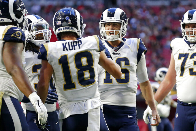 Los Angeles Rams wide receiver Cooper Kupp (18) celebrate his touchdown against the Arizona Cardinals with quarterback Jared Goff (16) during the second half of an NFL football game, Sunday, Dec. 1, 2019, in Glendale, Ariz. (AP Photo/Rick Scuteri)