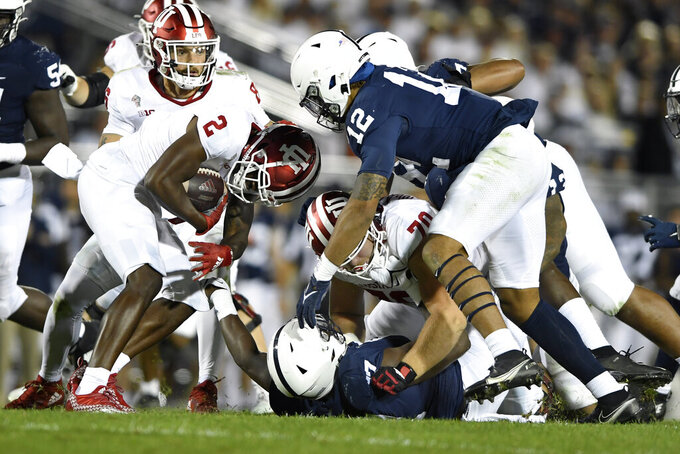 Penn State linebacker Brandon Smith (12) looks to tackle Indiana wide receiver Jacolby Hewitt (2) in the second quarter of their NCAA college football game in State College, Pa., on Saturday, Oct. 2, 2021.Penn State defeated Indiana 24-0. (AP Photo/Barry Reeger)