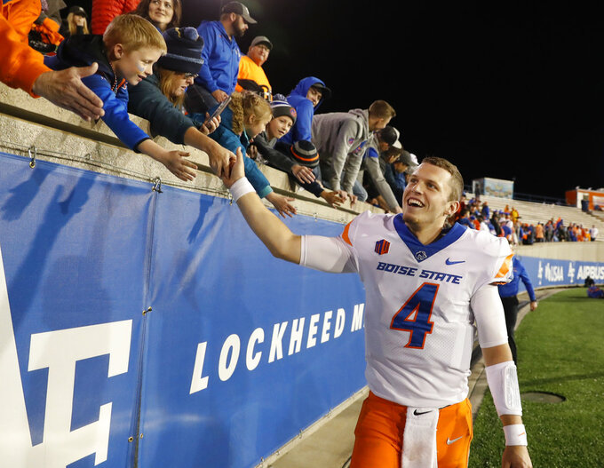 Fans congratulates Boise State quarterback Brett Rypien (4) after an NCAA college football game against Air Force, Saturday, Oct. 27, 2018, at Air Force Academy, Colo. (AP Photo/David Zalubowski)
