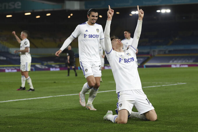 Leeds United's Diego Llorente, front, celebrates after scoring his side's opening goal during the English Premier League soccer match between Leeds United and Liverpool at the Elland Road stadium in Leeds, England, Monday, April 19, 2021. (Lee Smith/Pool via AP)