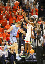 Virginia guard Casey Morsell (13) shoots over Columbia guard Jack Forrest (4) during an NCAA college basketball game in Charlottesville, Va., Saturday, Nov. 16, 2019. (AP Photo/Andrew Shurtleff)