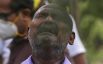 A man wails during the burial of a relative who died of COVID-19, at a cemetery in Mumbai, India, Tuesday, June 23, 2020. Some Indian states Tuesday were considering fresh lockdown measures to try to halt the spread of the virus in the nation of more than 1.3 billion. (AP Photo/Rafiq Maqbool)