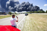 Jeff Phillips watches black smoke cloud billowing over Nazarene Drive Monday, June 14, 2021, in South Beloit, from the massive industrial fire at Chemtool on Prairie Hill Road in Rockton, Ill. (Scott P. Yates/Rockford Register Star via AP)