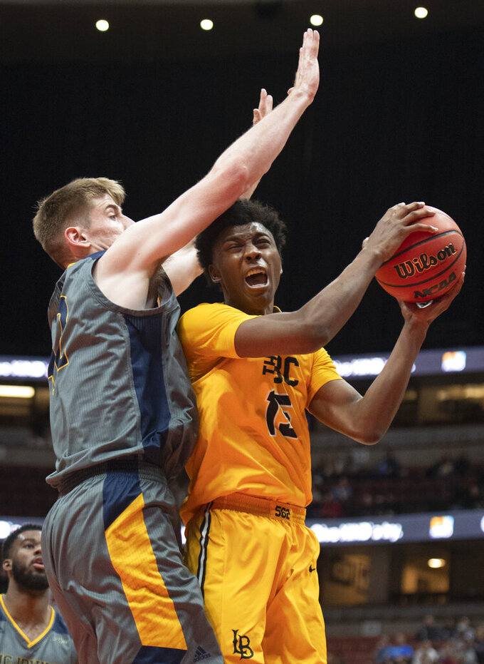 Long Beach State guard Deishuan Booker, right, goes up to the basket as UC Irvine forward Tommy Rutherford defends during the second half of an NCAA college basketball game at the Big West men's tournament in Anaheim, Calif., Friday, March 15, 2019. (AP Photo/Kyusung Gong)