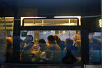 Commuters stand in a bus, in Paris, Wednesday, Dec. 11, 2019. After hundreds of thousands of angry protesters marched through French cities, the prime minister is expected to unveil proposals that might calm tensions on the 7th straight day of a crippling transport strike. (AP Photo/Thibault Camus)