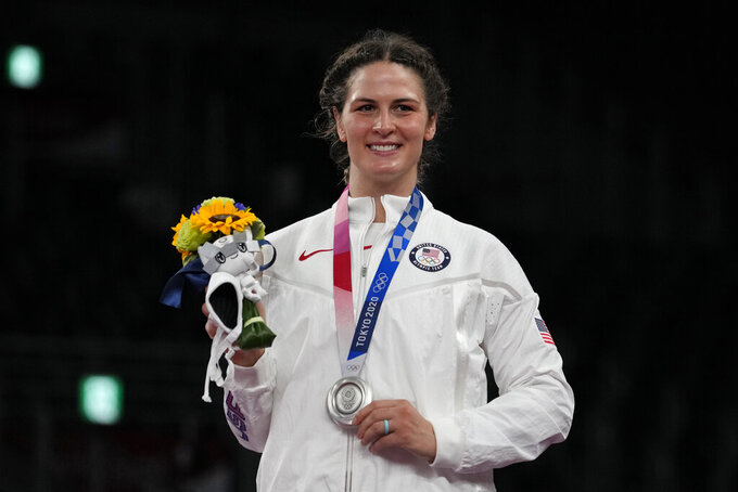 Silver medalist, United States Adeline Maria Gray celebrates during the ceremony medal for the women's 76kg freestyle wrestling at the 2020 Summer Olympics, Monday, Aug. 2, 2021, in Chiba, Japan. (AP Photo/Aaron Favila)