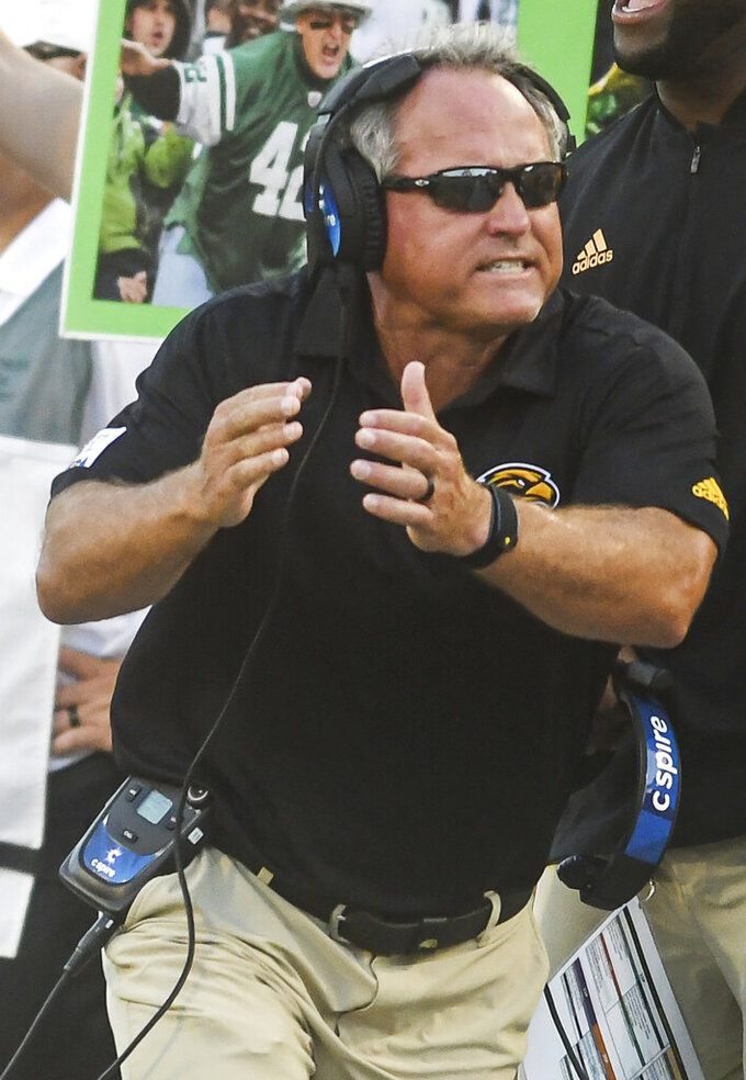 Southern Mississippi coach Jay Hopson encourages his players during the first half of an NCAA college football game against Alcorn State, Saturday, Aug. 31, 2019, in Hattiesburg, Miss. (Cam Bonelli/Hattiesburg American via AP)