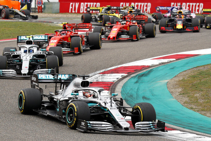 Mercedes driver Lewis Hamilton of Britain leads the field at the start of the Chinese Formula One Grand Prix at the Shanghai International Circuit in Shanghai, Sunday, April 14, 2019. (AP Photo/Andy Wong)