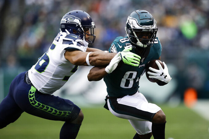 Philadelphia Eagles' Greg Ward Jr., right, is tackled by Seattle Seahawks' Mychal Kendricks during the first half of an NFL football game against the Seattle Seahawks, Sunday, Nov. 24, 2019, in Philadelphia. (AP Photo/Matt Rourke)