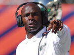 South Florida's head coach Charlie Strong calls out a play from the sidelines during the first half of an NCAA college football game against Illinois Saturday, Sept. 15, 2018, in Chicago. (AP Photo/Jim Young)