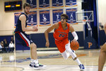 Pepperdine forward Kameron Edwards (20) drives past Gonzaga forward Drew Timme during the first half of an NCAA college basketball game Saturday, Feb. 15, 2020, in Malibu, Calif. (AP Photo/Ringo H.W. Chiu)