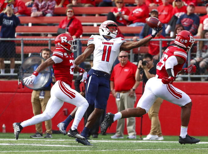 Langan's career day leads Rutgers past Liberty 44-34