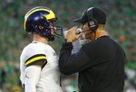 Michigan head coach Jim Harbaugh talks with quarterback Shea Patterson (2) in the first half of an NCAA football game against Notre Dame in South Bend, Ind., Saturday, Sept. 1, 2018. (AP Photo/Paul Sancya)