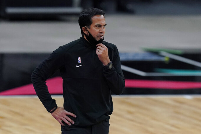 Miami Heat Erik Spoelstra talks to his players during the second half of an NBA basketball game against the San Antonio Spurs in San Antonio, Wednesday, April 21, 2021. (AP Photo/Eric Gay)