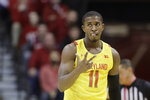 Maryland's Darryl Morsell (11) reacts after making a basket during the first half of an NCAA college basketball game against Indiana, Sunday, Jan. 26, 2020, in Bloomington, Ind. (AP Photo/Darron Cummings)