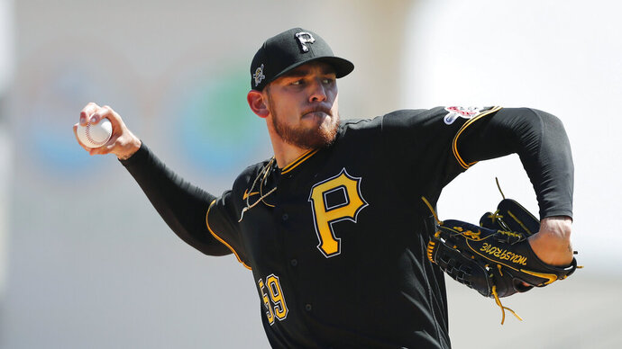 FILE - Pittsburgh Pirates starting pitcher Joe Musgrove plays during a spring training baseball game, Thursday, March 12, 2020, in Bradenton, Fla. Musgrove doesn't like wearing a mask more than any of his Pittsburgh Pirate teammates. Yet the pitcher wore one anyway  during the first day of workouts on Friday, just one way he is trying to lead  a pitching staff searching for an ace with Jameson Taillon and Chris Archer already out for 2020. (AP Photo/Carlos Osorio)