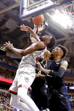 North Carolina State's  DJ Funderburk, left, goes up for a shot as Pittsburgh's Terrell Brown, right, defends during the first half of an NCAA college basketball game, Saturday, Feb. 9, 2019, in Pittsburgh. (AP Photo/Keith Srakocic)