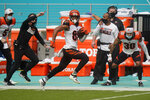 Cincinnati Bengals wide receiver Tyler Boyd (83) runs for a touchdown during the first half of an NFL football game against the Miami Dolphins, Sunday, Dec. 6, 2020, in Miami Gardens, Fla. (AP Photo/Wilfredo Lee)