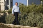 The leader of the Yisrael Beiteinu (Israel Our Home) right-wing nationalist party Avigdor Liberman arrives to votein the settlement of Nokdim, West Bank, Tuesday, Sept. 17, 2019. (AP Photo/Tsafrir Abayov)