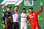 From left, second placed Dutch Formula One driver Max Verstappen of Red Bull, Chief Strategist of Mercedes team James Vowles, winner British Lewis Hamilton of Mercedes and third placed German Sebastian Vettel of Ferrari celebrate on the podium during the award ceremony of the Hungarian Formula One Grand Prix at the Hungaroring circuit, in Mogyorod, Hungary, Sunday, Aug. 4, 2019. (Zsolt Czegledi/MTI via AP)