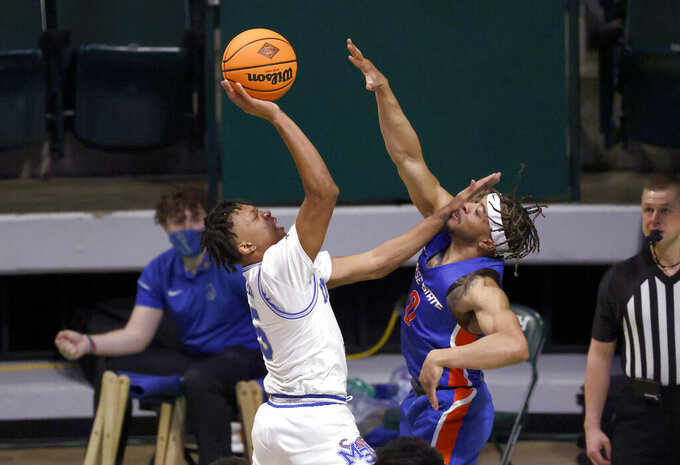 Memphis guard Boogie Ellis (5) shoots as Boise State guard Marcus Shaver Jr. (0) defends during the first half of an NCAA college basketball game in the semifinals of the NIT, Thursday, March 25, 2021, in Denton, Texas. (AP Photo/Ron Jenkins)