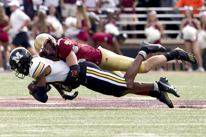Missouri wide receiver JJ Hester (13) is wrapped up by Boston College defensive back Mike Palmer (18) after making a catch during the second half of an NCAA college football game, Saturday, Sept. 25, 2021, in Boston. (AP Photo/Mary Schwalm)