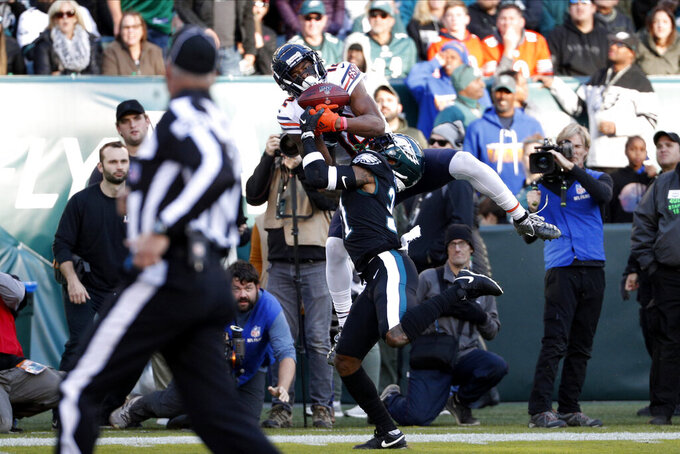 Chicago Bears' Allen Robinson (12) cannot hang onto a pass against Philadelphia Eagles' Jalen Mills (31) during the second half of an NFL football game, Sunday, Nov. 3, 2019, in Philadelphia. (AP Photo/Chris Szagola)