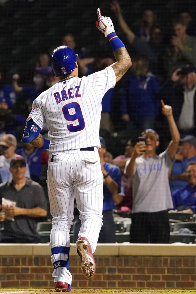 Chicago Cubs' Javier Baez celebrates after hitting a solo home run during the ninth inning of a baseball game against the Washington Nationals in Chicago, Wednesday, May 19, 2021. The Nationals won 4-3. (AP Photo/Nam Y. Huh)