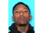 This undated photo provided by the New Orleans Police Department shows LaBryson Polidore. Still at large at this time of reporting was Polidore, 22, who faced 10 counts of attempted second-degree murder. Polidore was hit in the foot during the gunfight, Police Chief Shaun Ferguson said. (New Orleans Police Department via AP)