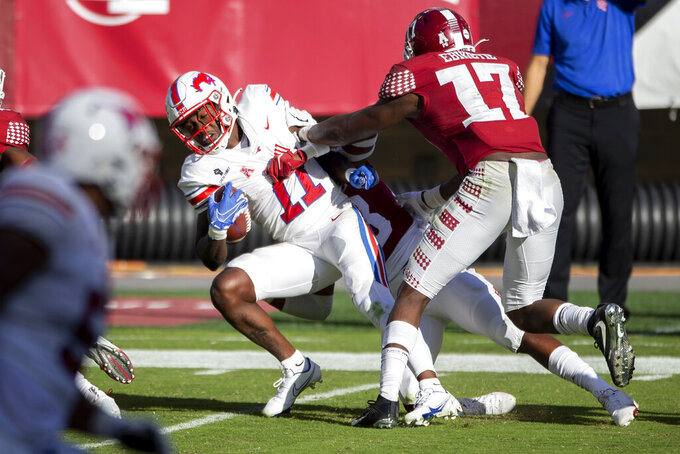 SMU wide receiver Rashee Rice (11) is tackled by Temple linebacker Isaiah Graham-Mobley (8) and defensive end Arnold Ebiketie (17) during the second half of an NCAA college football game, Saturday, Nov. 7, 2020, in Philadelphia. SMU won 47-23. (AP Photo/Laurence Kesterson)